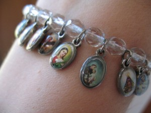 Coolest bracelet ever (each medallion is a different saint).