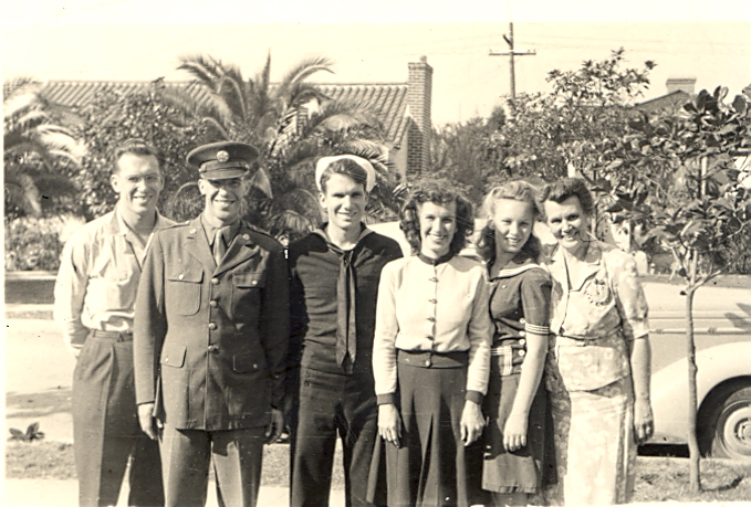 My great-grandmother, far right, with her children, 1944.  Left to right: Baxter (my grandfather); Walt; Bob; Helen; Carol Ann.